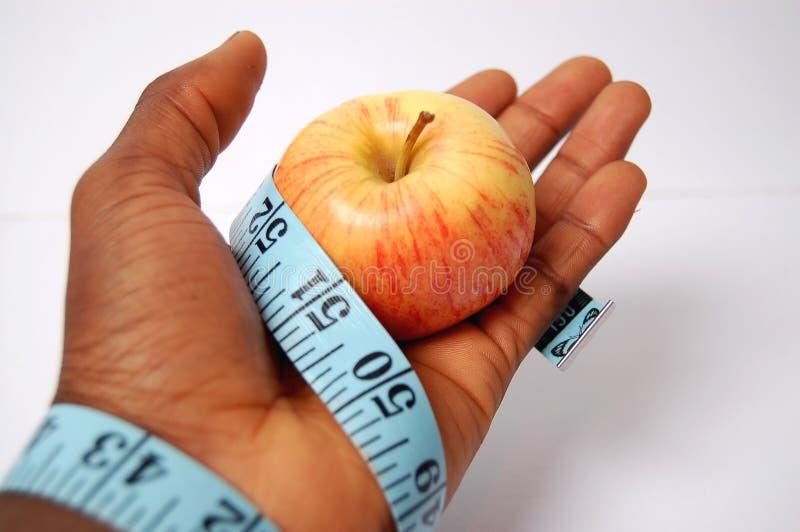 Gebunden in einer Diät Apple lizenzfreie stockfotografie