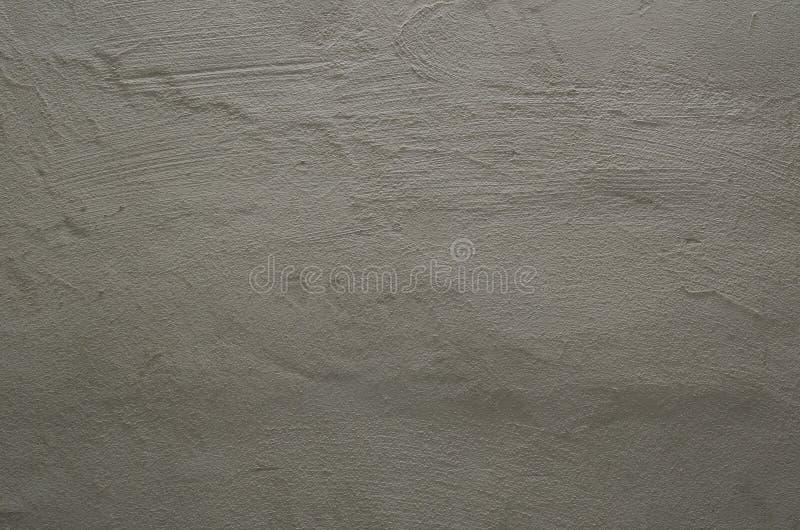 Geconcentreerde textuur van korrelige lawaaierige grijze muur royalty-vrije stock foto