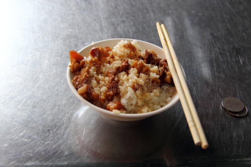 Gedünsteter Schweinefleisch-Reis stockbilder