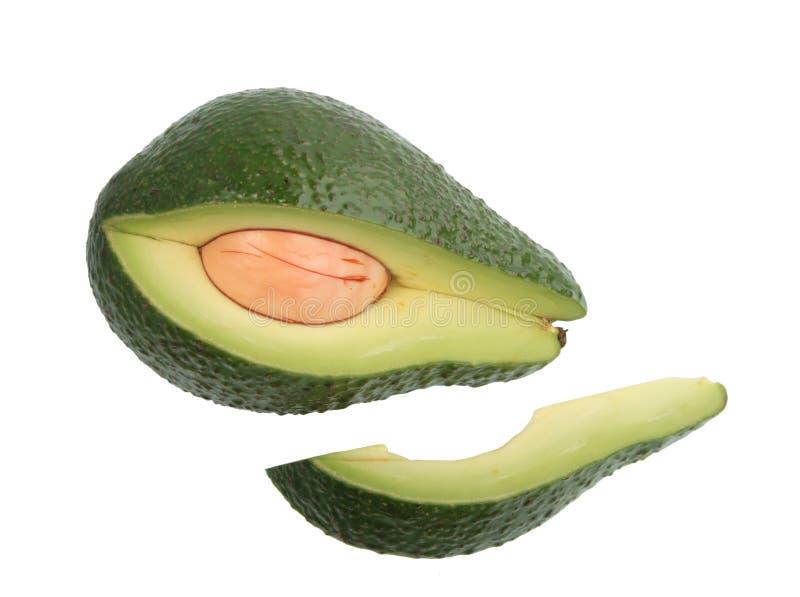 Gedeelte van enige groene avocado. royalty-vrije stock afbeelding