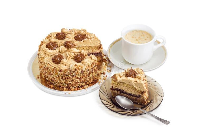 Gedeeltelijk gesneden gelaagde biscuitgebak en koffie met room royalty-vrije stock fotografie