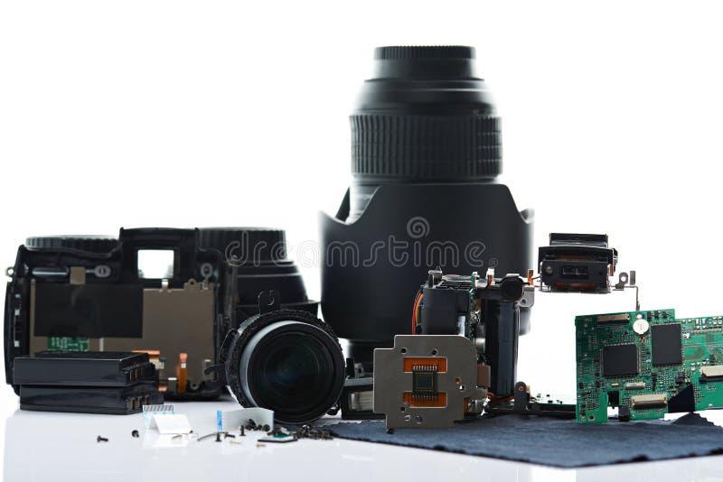 Gedemonteerde cameradelen stock afbeelding