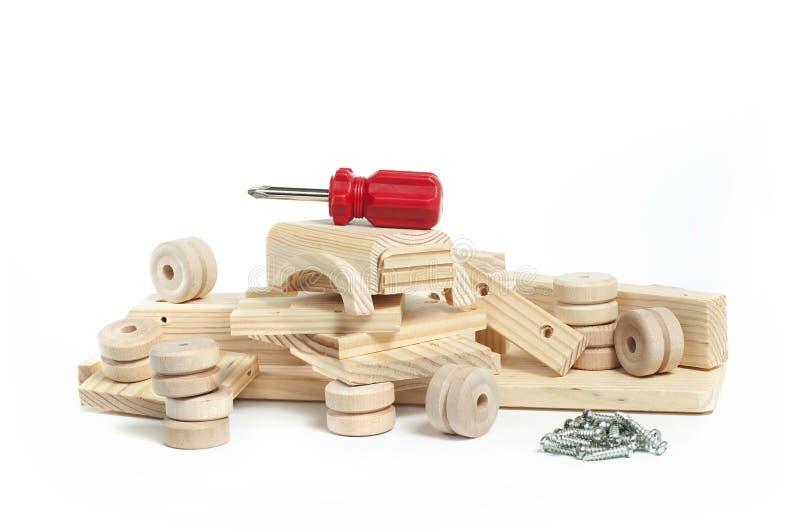 Gedemonteerde houten stuk speelgoed auto stock foto's