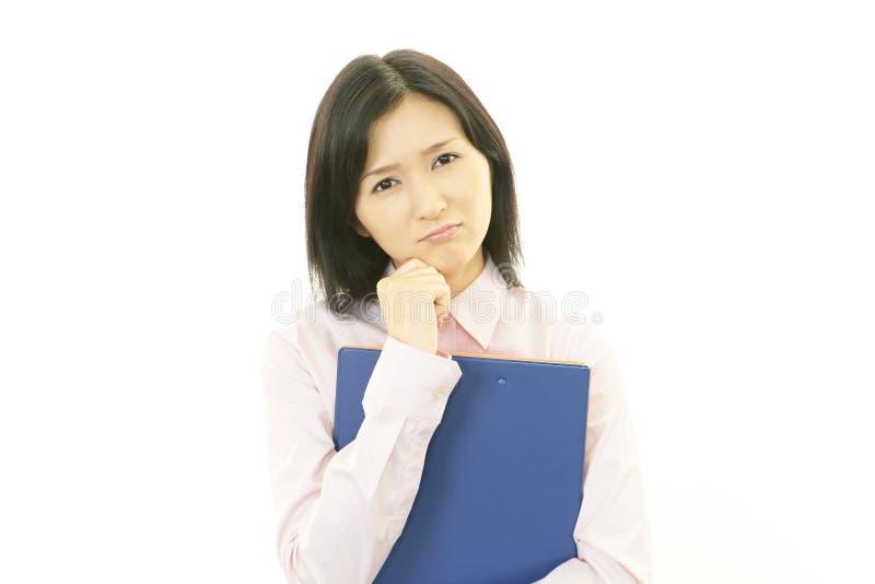 Gedeprimeerde bedrijfsvrouw. stock afbeelding