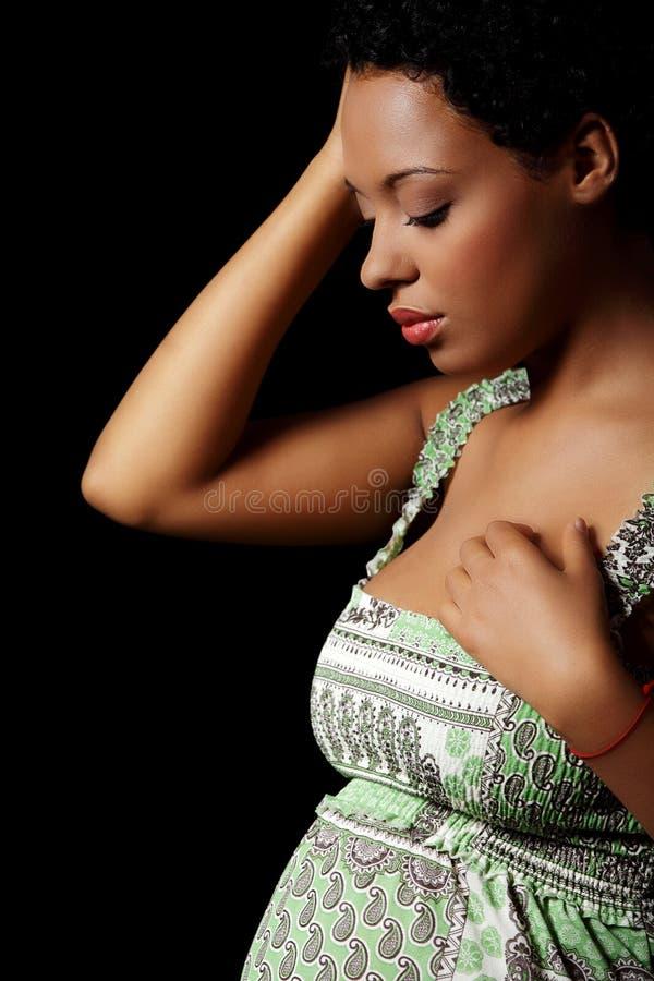 Gedeprimeerde zwangere vrouw stock fotografie