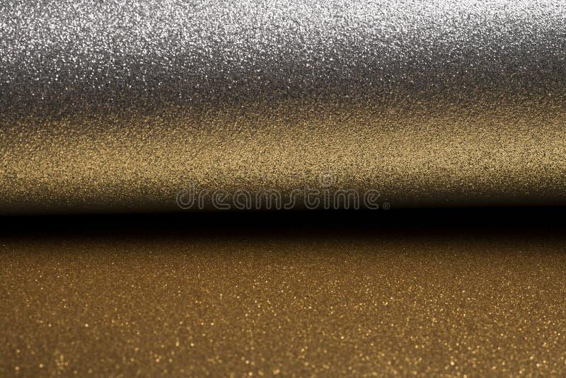 Gedetailleerde textuur van schitterende zilver en stofgoudoppervlakte voor Kerstmis stock foto's