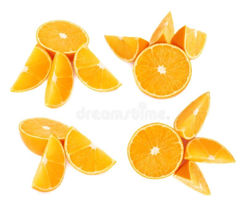 Gediende oranje die fruitsamenstelling over de witte achtergrond, reeks wordt geïsoleerd verschillende foreshortenings royalty-vrije stock afbeeldingen