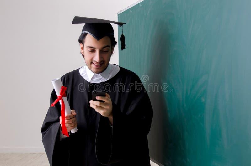 Gediplomeerde student voor groene raad stock foto's