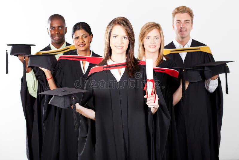 Gediplomeerden bij graduatie stock foto