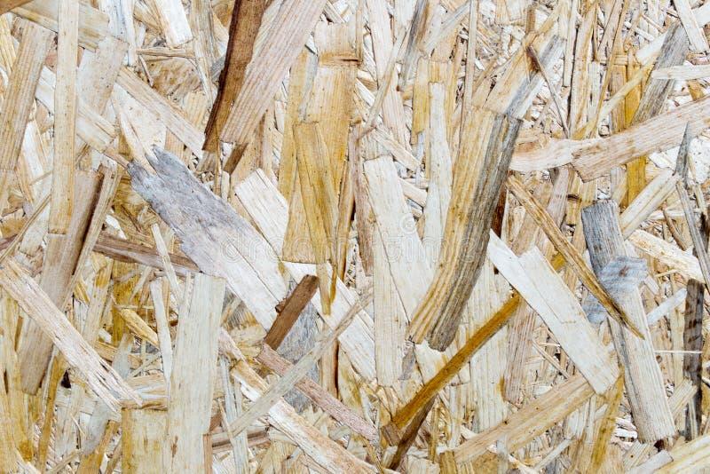 Gedrukte houten paneelachtergrond, naadloze textuur van georiënteerde bundelraad - OSB-hout stock foto's
