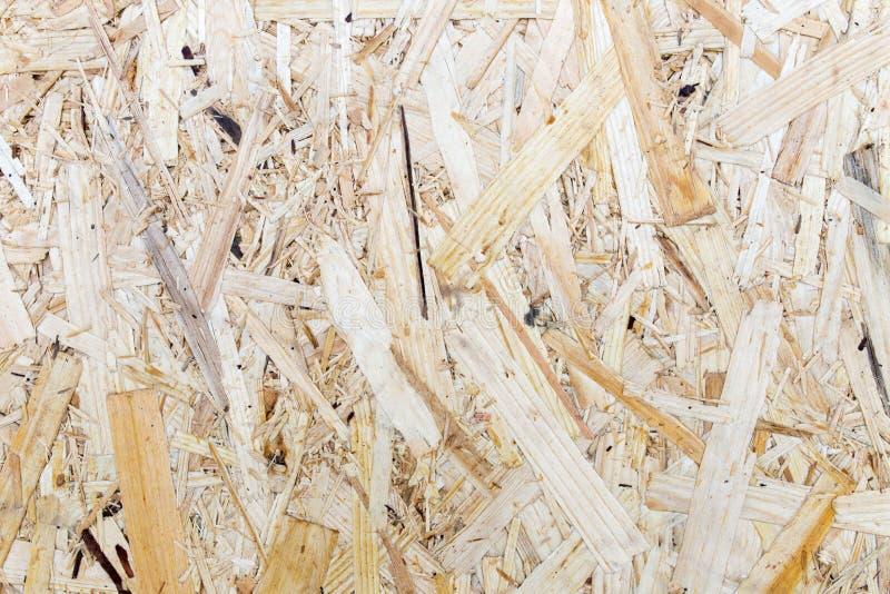 Gedrukte houten paneelachtergrond, naadloze textuur van georiënteerde bundelraad - OSB-hout royalty-vrije stock foto's