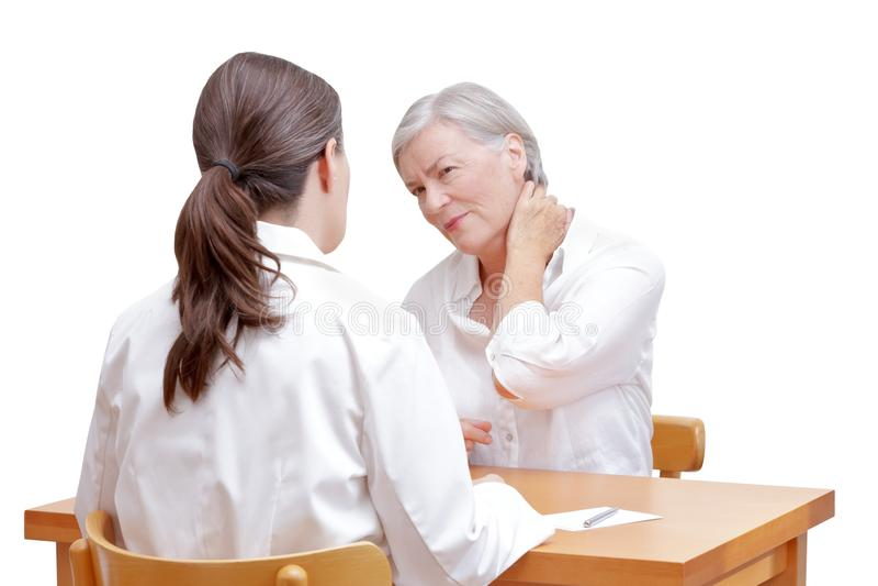Geduldige Nackenschmerzenspannung Doktors stockbild
