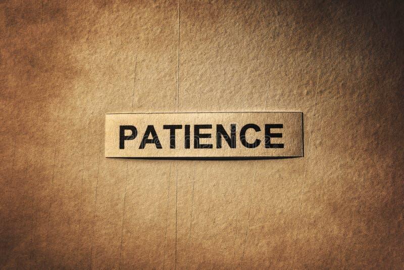 Geduldwoord met krassendocument stock afbeelding