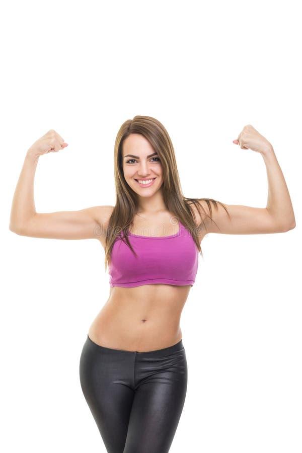 Geeignete junge Frau überzeugt hinsichtlich ihres Körpers lizenzfreies stockbild