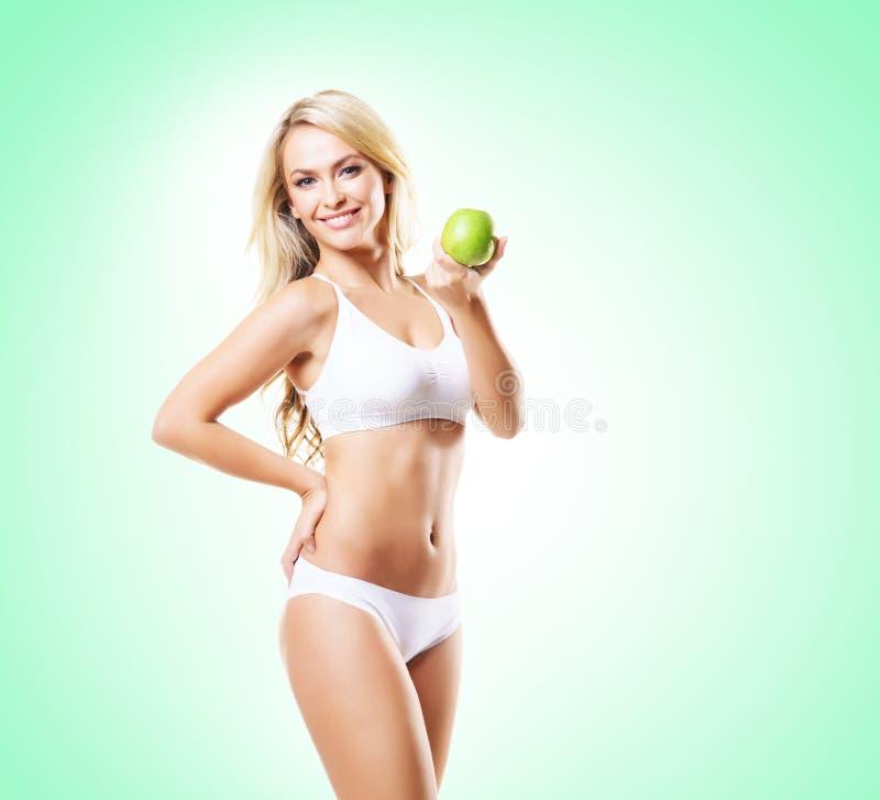 Geeignetes und sportliches Mädchen in der weißen Unterwäsche Schöner und gesunder wo stockfoto