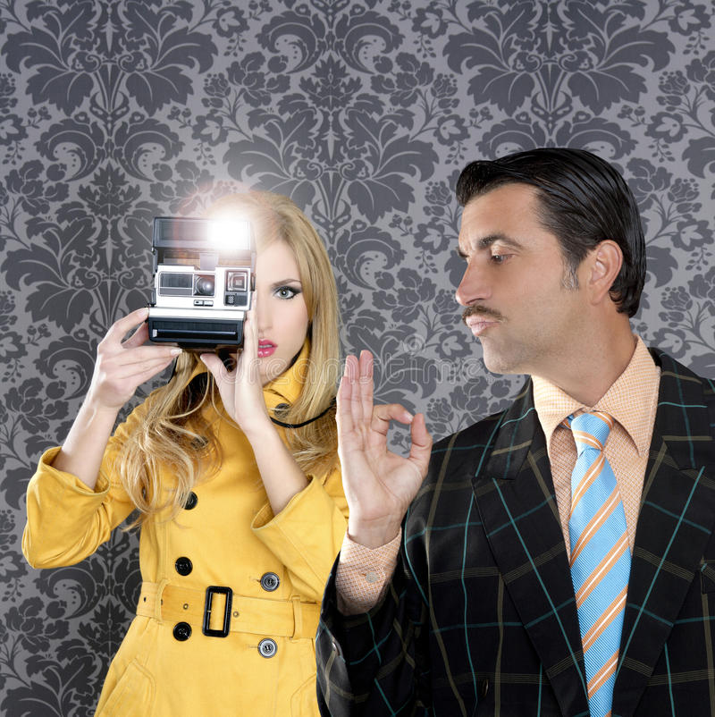 Geek mustache man reporter fashion girl. Geek tacky mustache man reporter fashion girl photo shoot retro wallpaper royalty free stock photo