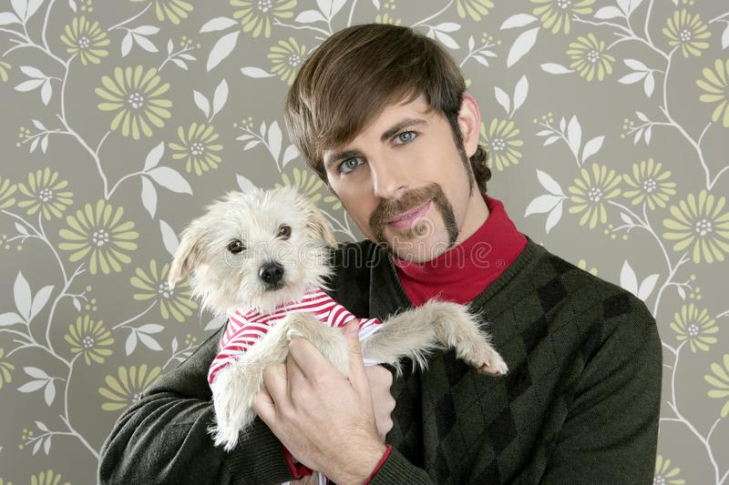 Geek retro man holding dog silly on wallpaper royalty free stock image