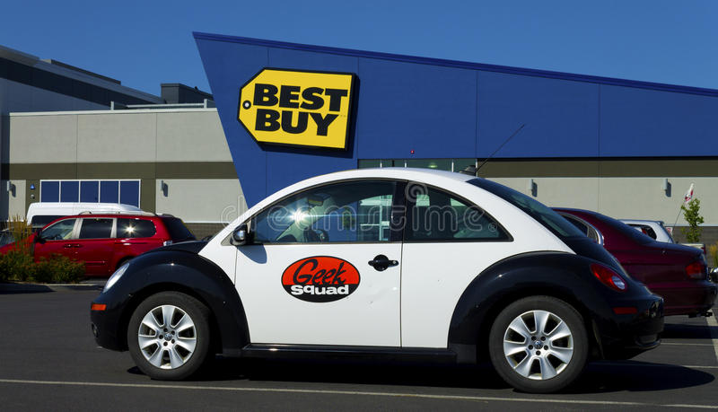 Geek Squad car. A Geek squad volkswagen beetle part of the fleet of Best Buy tech support, with the best buy retail store in the background stock photo