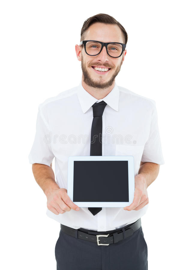 Geeky businessman showing his tablet pc. On white background stock images