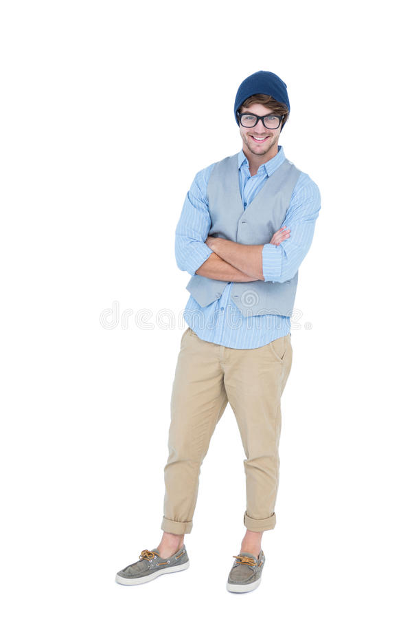 Geeky hipster with arms crossed looking at camera. On white background royalty free stock image