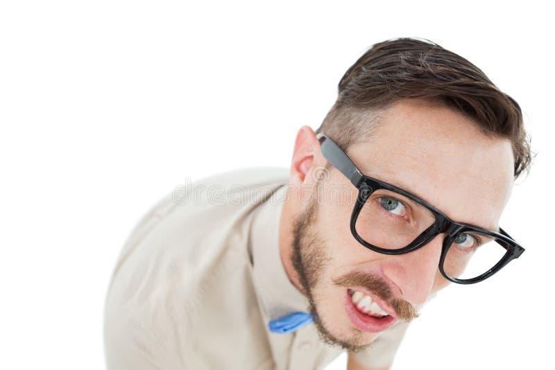 Geeky hipster looking at camera royalty free stock photo