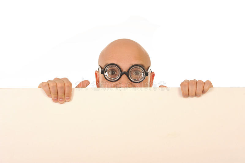 Geeky looking man wearing strange glasses holding blank sign stock photography