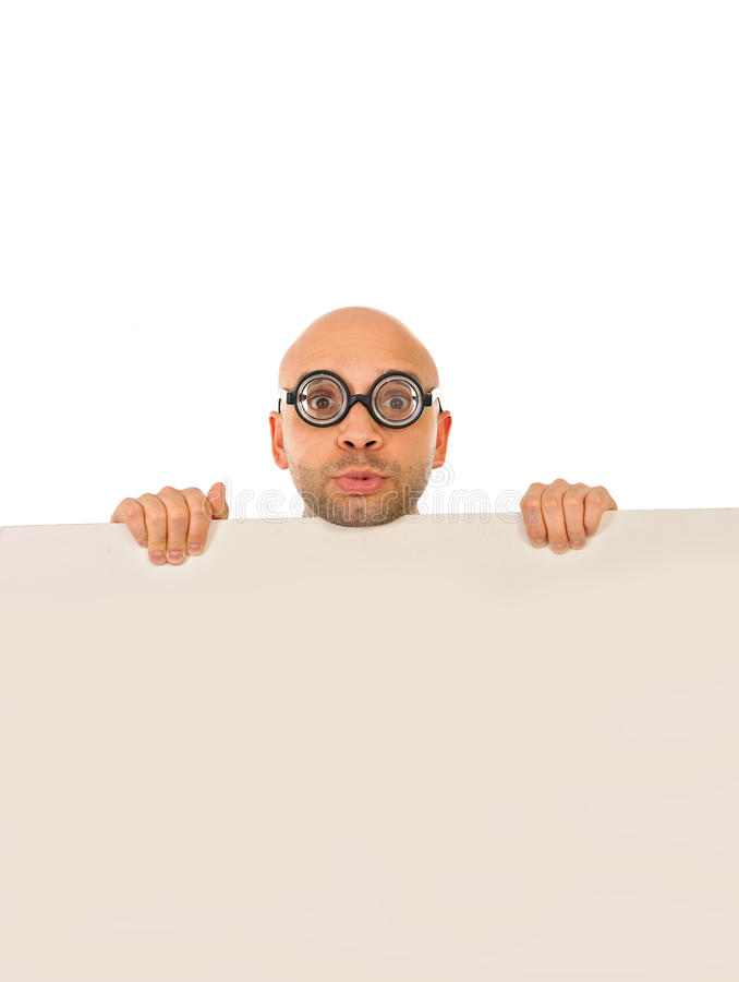 Geeky looking man wearing strange glasses holding blank sign royalty free stock image