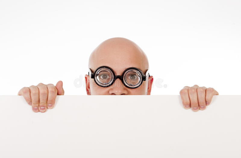Geeky looking man wearing strange glasses holding blank sign royalty free stock photo