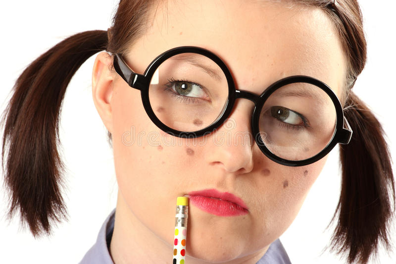Geeky teenage girl in thought stock photo
