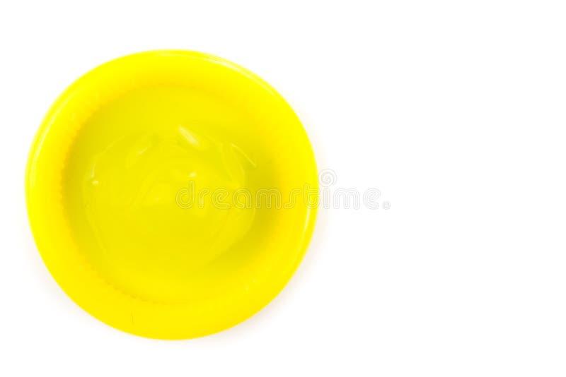 Geel condoom stock fotografie