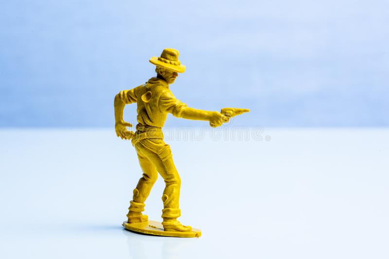 Geel cowboy plastic stuk speelgoed cijfer royalty-vrije stock afbeeldingen