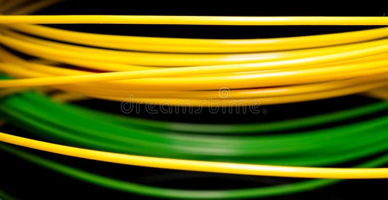 Geel en groen ABS plastiek voor 3D printer stock fotografie