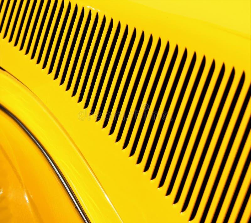 Geel en zwart detailpatroon op een oude klassieke auto stock fotografie
