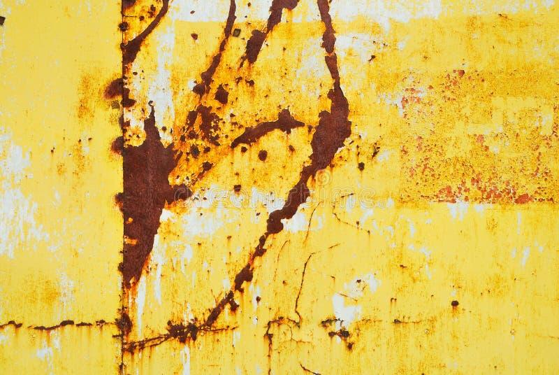 Geel geschilderd metaal met roesttextuur royalty-vrije stock fotografie