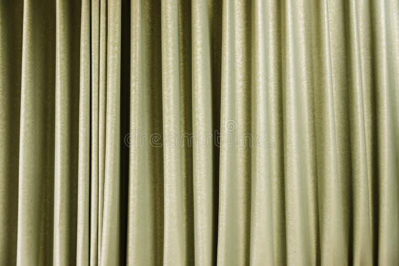 Geel gordijn, abstracte textuur voor achtergrond royalty-vrije stock fotografie
