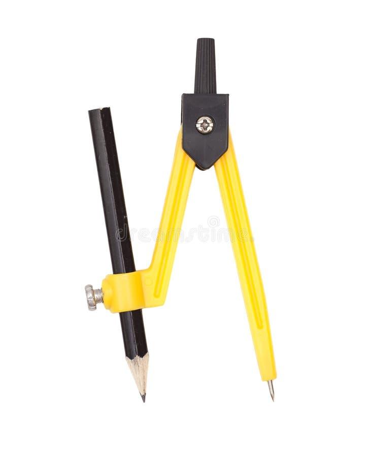 Geel kompas met potlood royalty-vrije stock foto