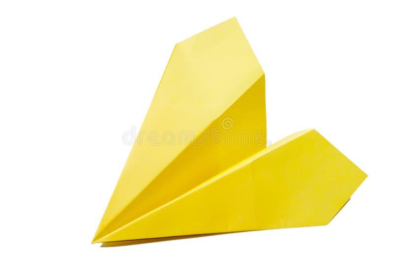 Geel origamivliegtuig op een witte achtergrond stock fotografie