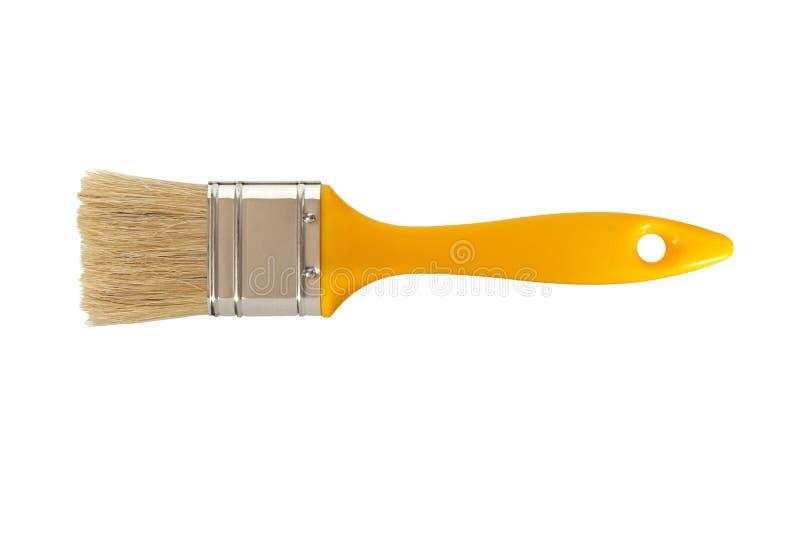 Geel penseel op wit stock foto