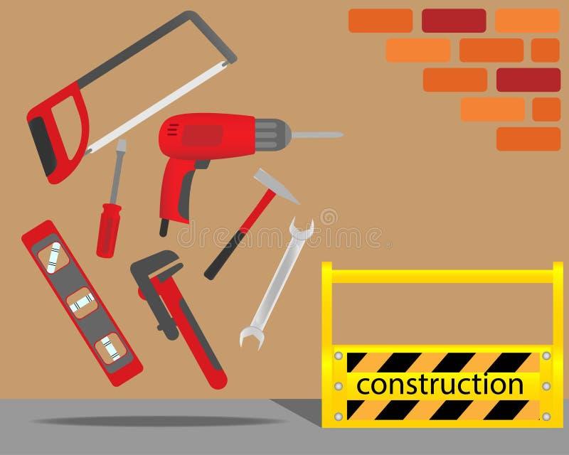 Geel toolbox en reparatiemateriaal op de bakstenen muurachtergrond stock fotografie