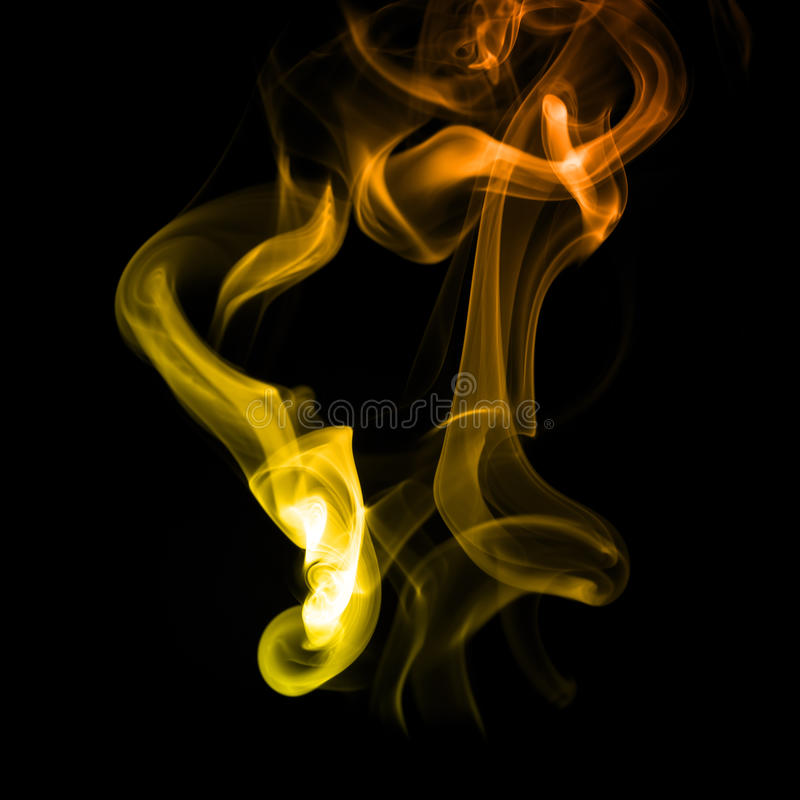 Geeloranje rook stock afbeeldingen