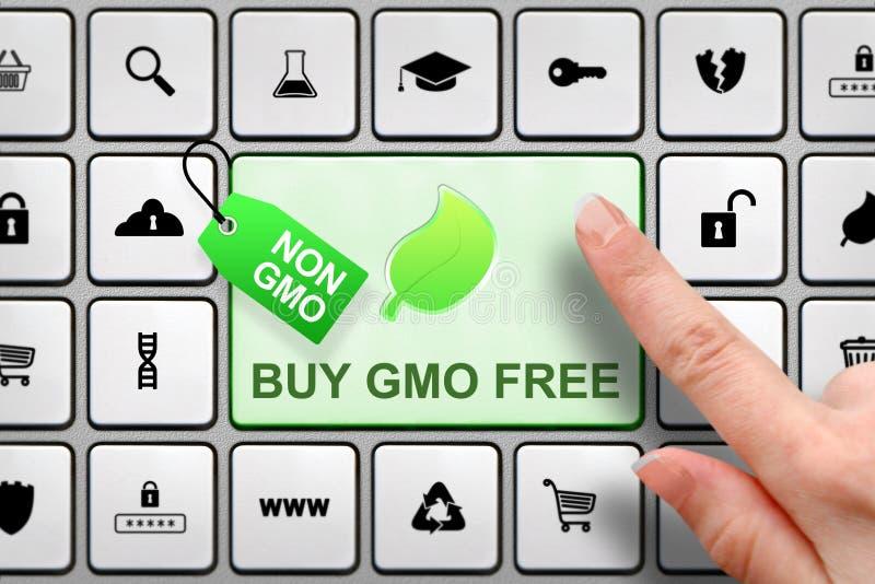 Geen GMO-concept, meisjes` s vinger boven de grote knoop op het toetsenbord stock afbeelding