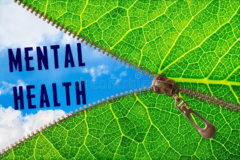 Geestelijk gezondheidswoord onder ritssluitingsblad stock foto