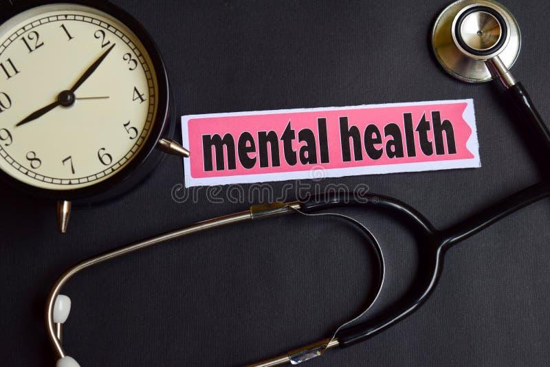 Geestelijke Gezondheid op het document met de Inspiratie van het Gezondheidszorgconcept wekker, Zwarte stethoscoop stock foto's