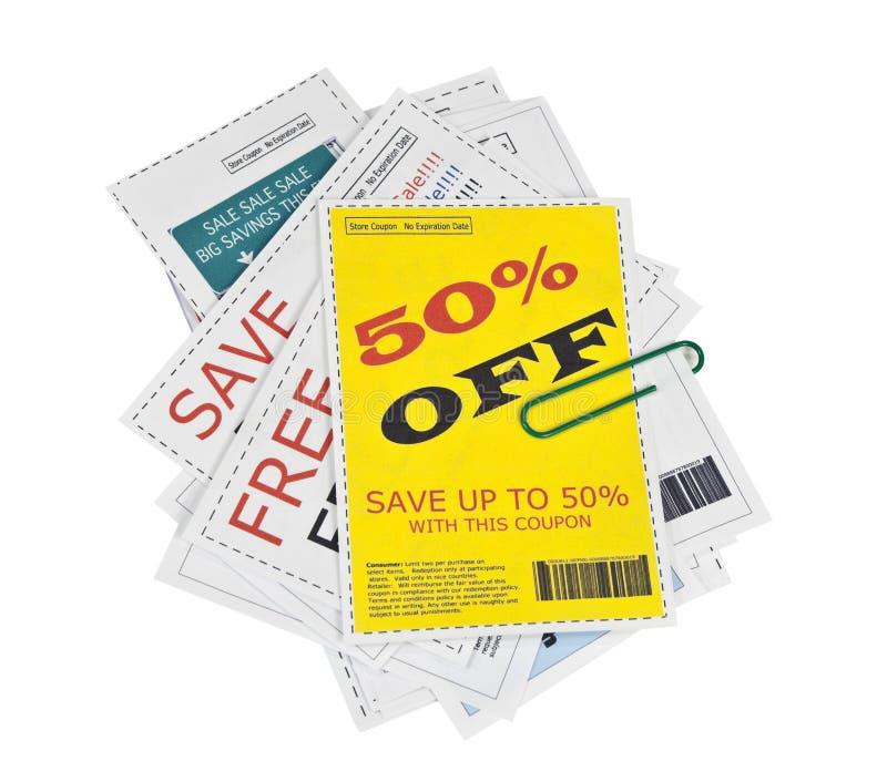 Gefälschte Kupon-Ausschnitte mit Papierklammer lizenzfreie stockbilder