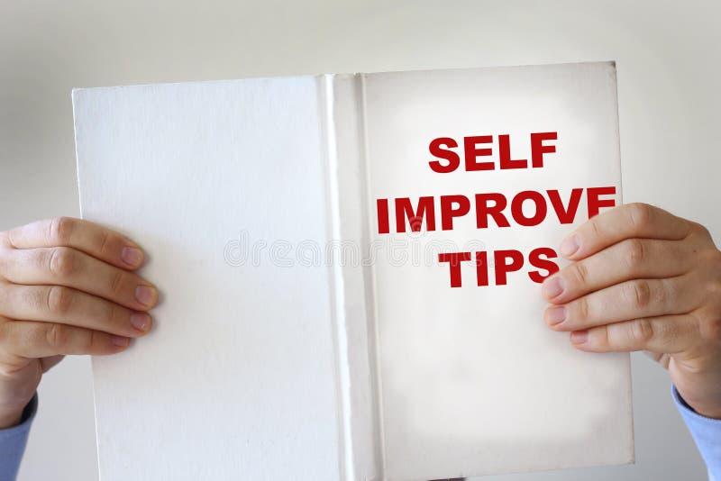 Gefälschtes Buch der Selbstverbesserung stockbild