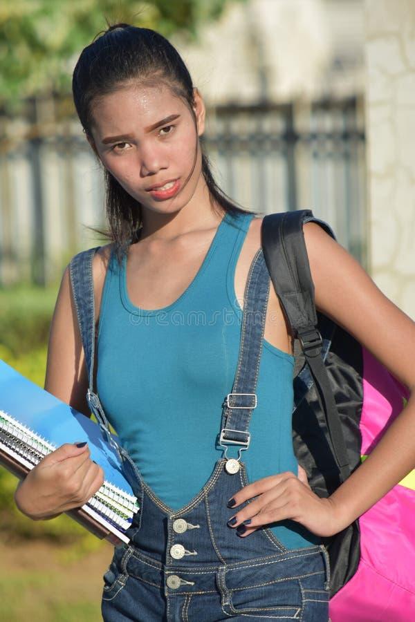 Gefühllose junge Studentin With Notebooks lizenzfreie stockfotografie