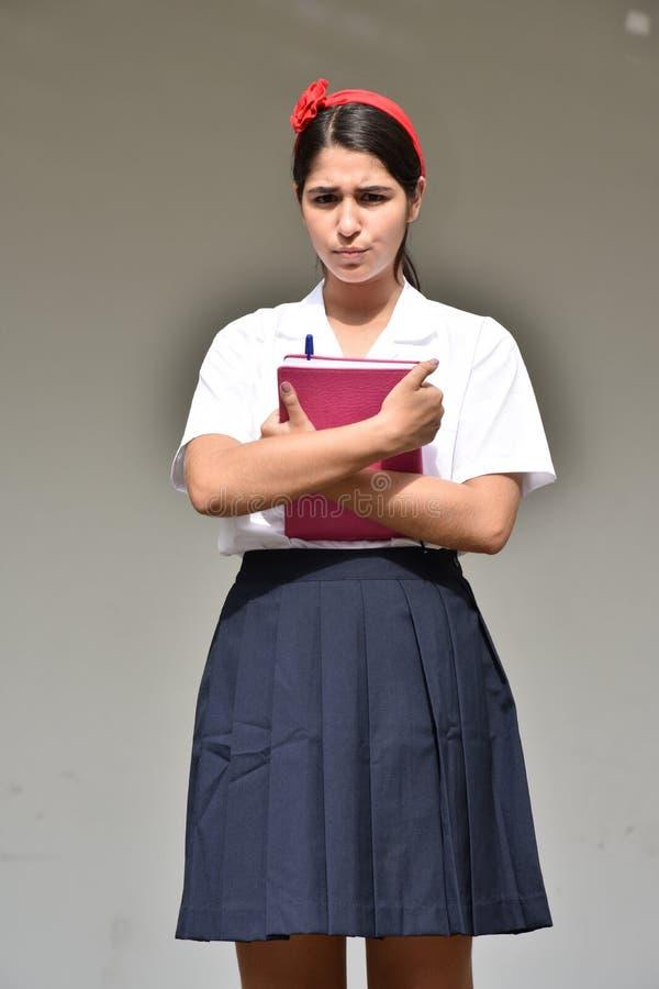 Gefühllose katholische kolumbianische Studentin Wearing Uniform lizenzfreie stockfotos