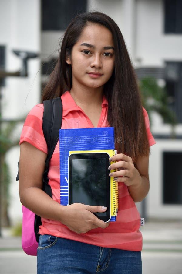 Gefühlloser Minderheitsstudent With Notebooks lizenzfreie stockbilder