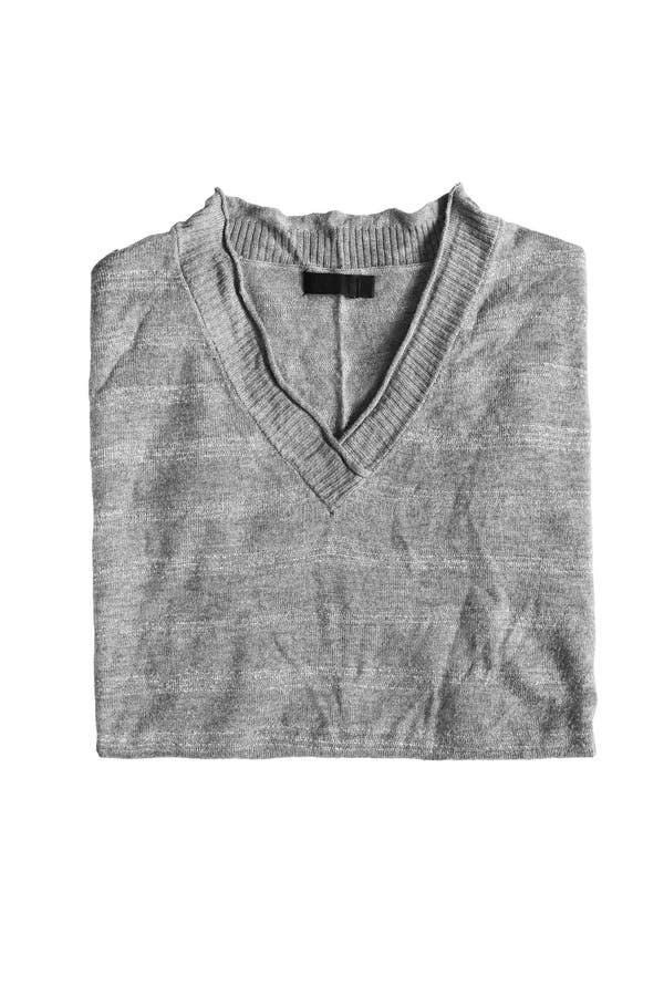 Gefalteter grauer Pullover lizenzfreies stockbild