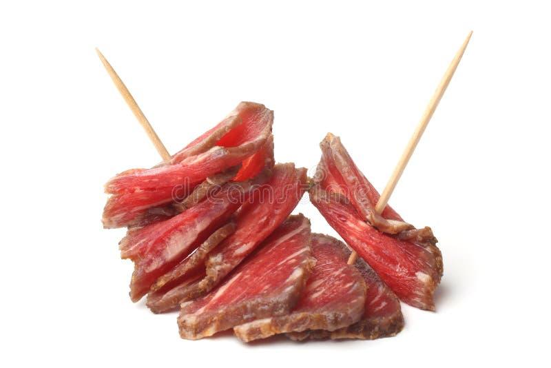 Gefaltetes Rindfleisch carpaccio mariniert im Rotwein stockbilder